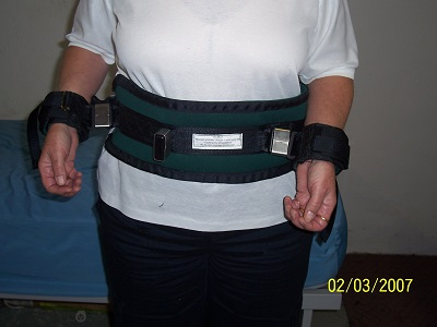 Cuffs attached to waist belt.